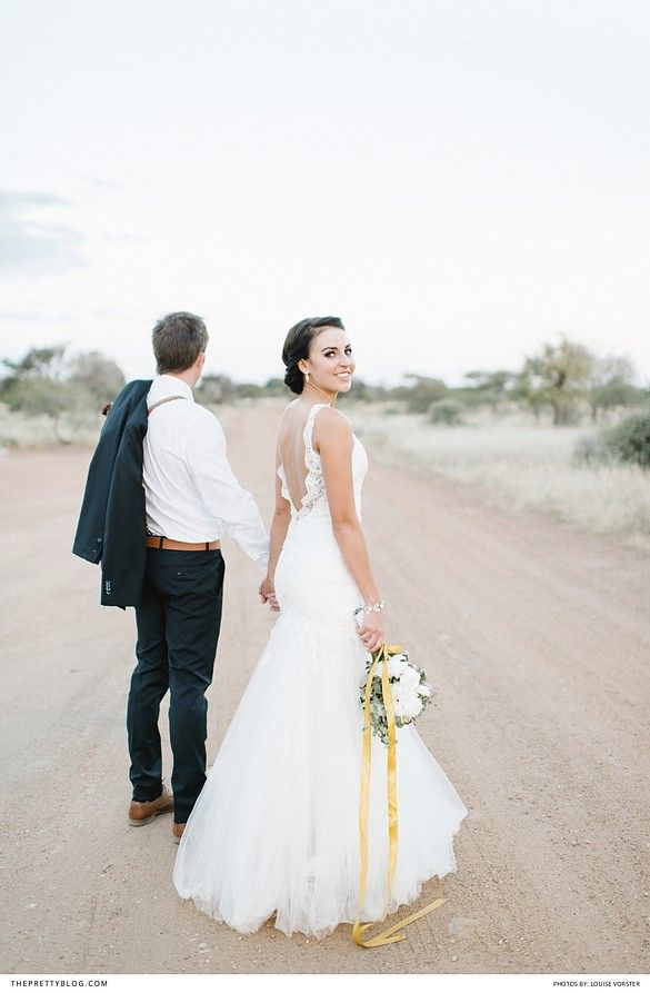 Mermaid wedding dress with open back and lace detail, with a golden leaf hair-piece and soft white bouquet   Venue: Bordeaux Game Farm   Photographers: Louise Vorster Photography   Wedding dress: Joss Bridal Wear   Flowers: Bloom Floral Design   Make-up: Opgedollie   Jewellery & Accesories: Lorean Jewellery   Hair: Tharien du Toit  