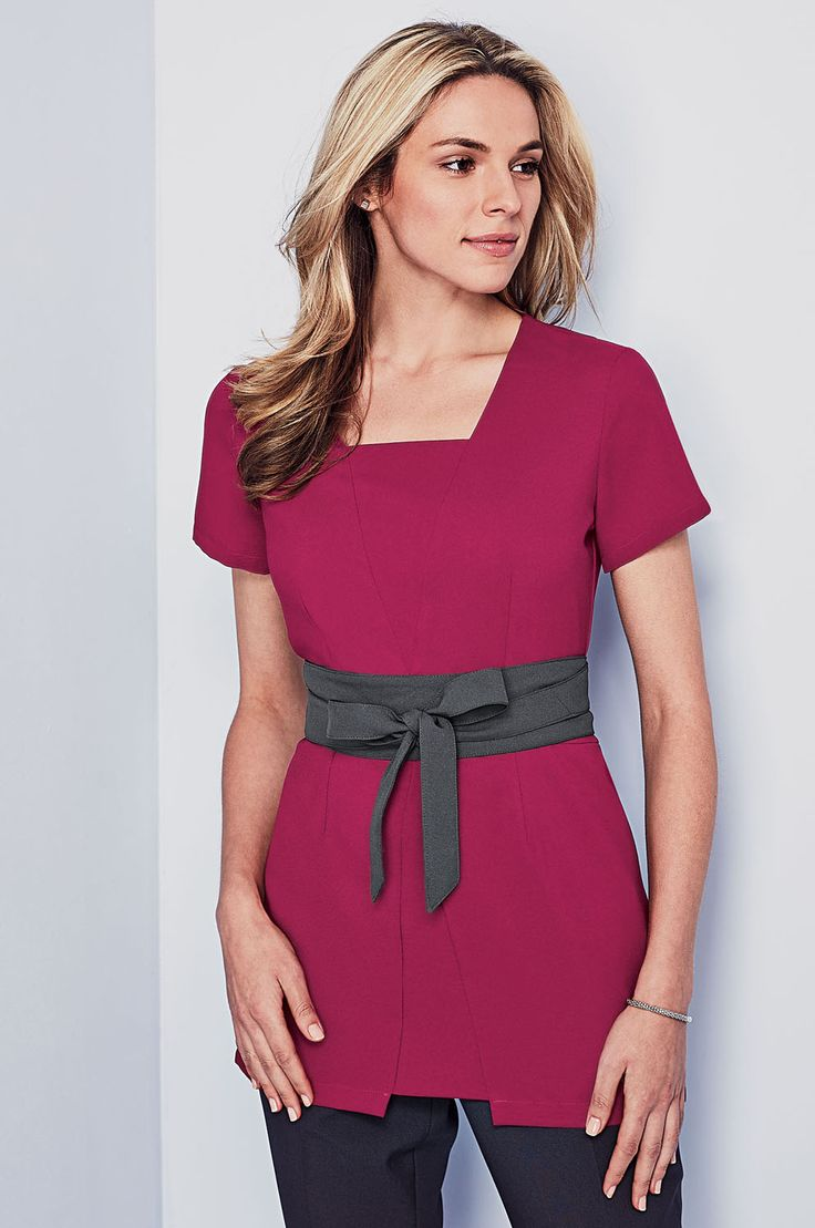 NEW sophisticated beauty tunic in this season's must-have colour, raspberry, styled with a graphite sash. Shop at www.simonjersey.com for beauty tunics, beautician uniforms, beauty therapist's tunic, salon uniforms, spa uniforms, hairdressing tunics. Perfect for many work places including beauty salons, spas, hairdressing salons, cosmetic surgeries, dog grooming salons, hotels, boutique hotels and more.