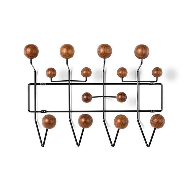 The #classic #Eames #hangitall was introduced in #1953 as part of Charles' and Ray's #kids range. First crafted with multicoloured ball hooks and a white wire frame, the finishes have been expanded to add sophistication and accommodate a range of interiors beyond the #nursery.  To create the rack's framework, which attaches to your #wall or door, the same mass-production technique were applied for welding wires that had been developed for some of the Eames' wire base #furniture #designs…