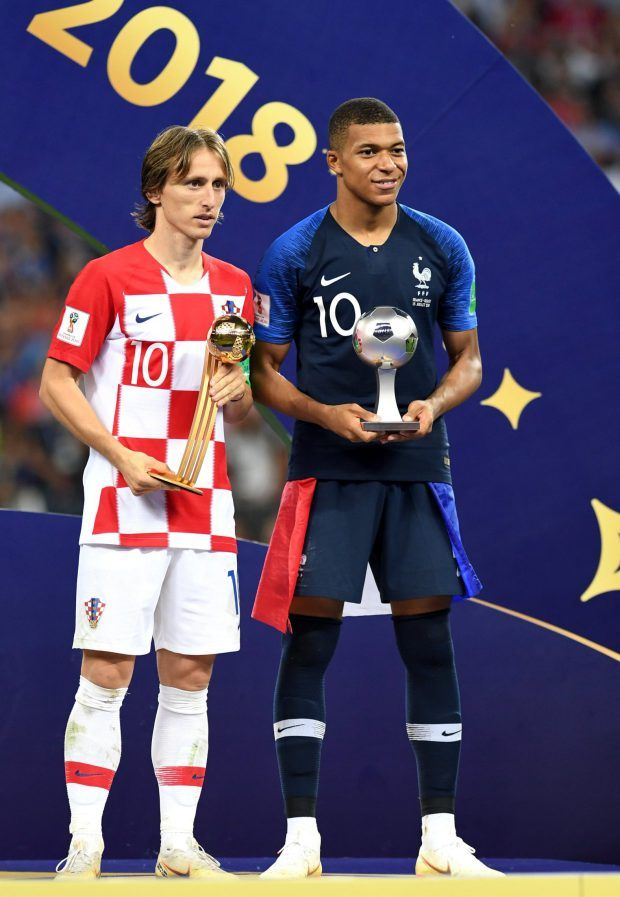f4a8f8d26b93 MOSCOW, RUSSIA - JULY 15: Luka Modric of Croatia and Kylian Mbappe of  France pose respectively with their the adidas Golden Ball and with the  FIFA Young ...