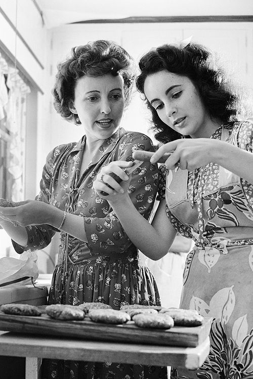 Elizabeth Taylor helps her mother, Sara,  prepare hotdogs and hamburgers at home, photographed by Earl Theisen, 1947.