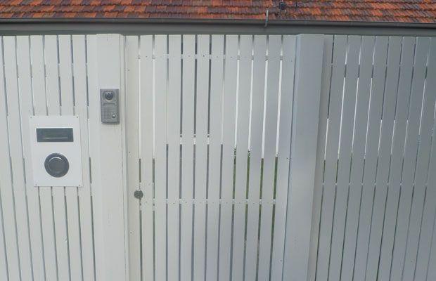 Flat top picket pedestrian gate with lock.