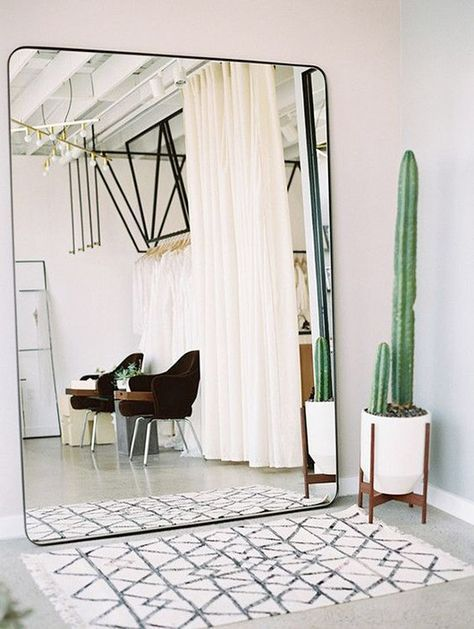 A huge mirror visually doubles the space in a room | #textiles #interior