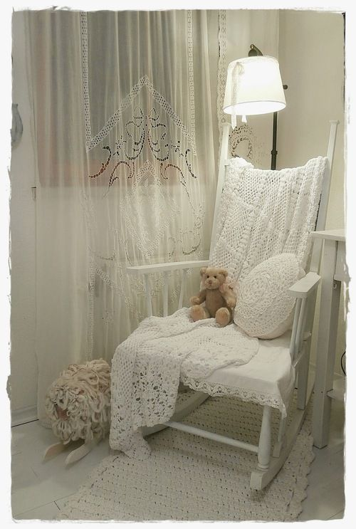 A rocking chair would be nice and you can add a throw or pillows with different design to add flair. You could also include an ottoman.