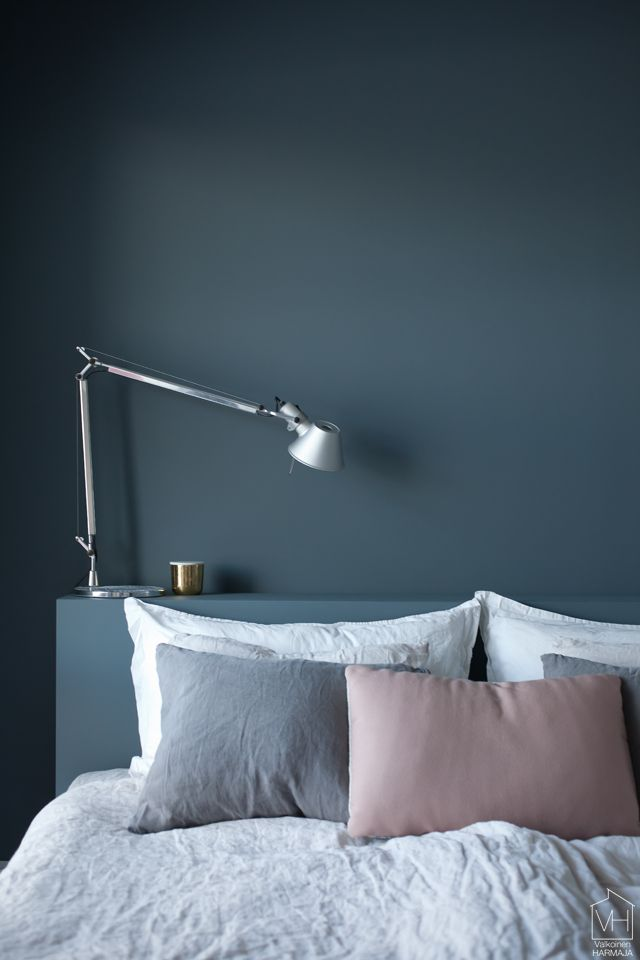 Bedroom wall in petrol blue.