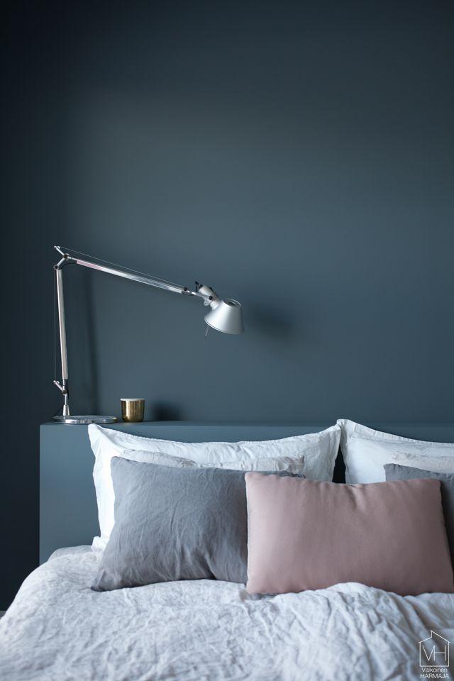Bedroom wall in petrol blue.