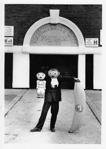 Frank Sidebottom and Little Frank outside the old Manchester City ground with a big inflatable banana. Of course. Support the Frank Sidebottom Doc. http://www.kickstarter.com/projects/126673955/being-frank-the-chris-sievey-story/