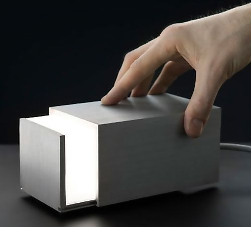 Creative Lamps and Unusual Light Designs   Box Lamp: Designed by J Hakaniemi, this interactive lamp can be manually adjusted by opening and closing the box.