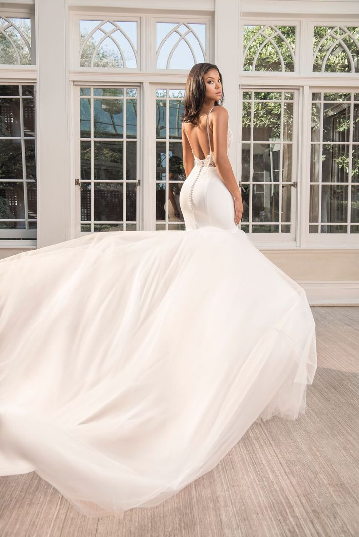 Eniko Parrish wore a custom Vera Wang wedding gown with lace bodice and tulle…