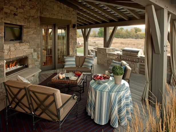The roof design and layout of the room is ideal for the lower cooking deck.  HGTV Dream Home 2012's outdoor living room, designer Linda Woodrum furnished the space with a trio of sturdy, solid aluminum loveseats with cushions made of stain-, mold- and mildew-resistant fabric.