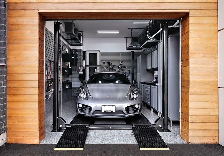 Silver Porsche on 4 post car lift inside residential garage