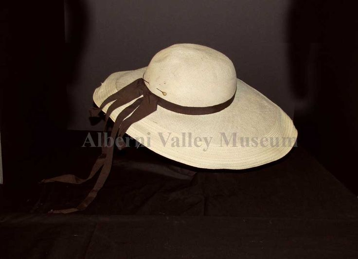 Large off-white picture hat with a deep crown and wide brim, 1947-55.  Hat styles varied in the 1940s, ranging from very large to quite small.  One style was a wide picture hat, sometimes with a deep crown as in this example and sometimes with very shallow crowns.  [Alberni Valley Museum Collection 1971.84.1g]