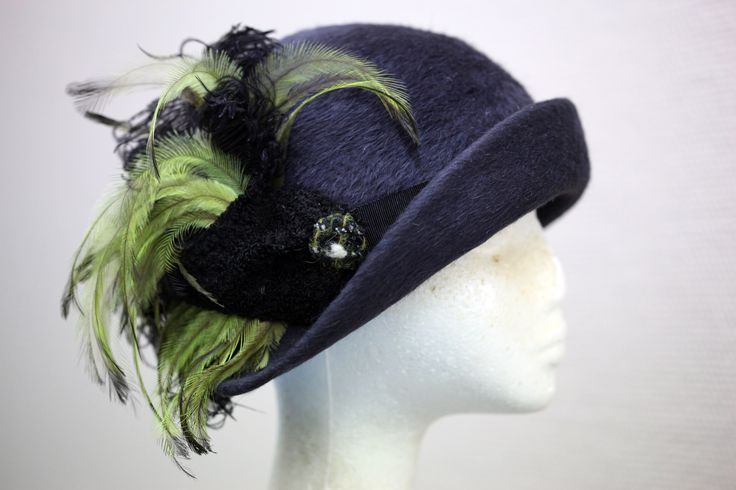 This hat was made to go with one of Phryne's winter coats. It is made from beautiful quality felt and antique feathers.