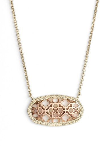 In love with this gold and rose gold pendant necklace by Kendra Scott!