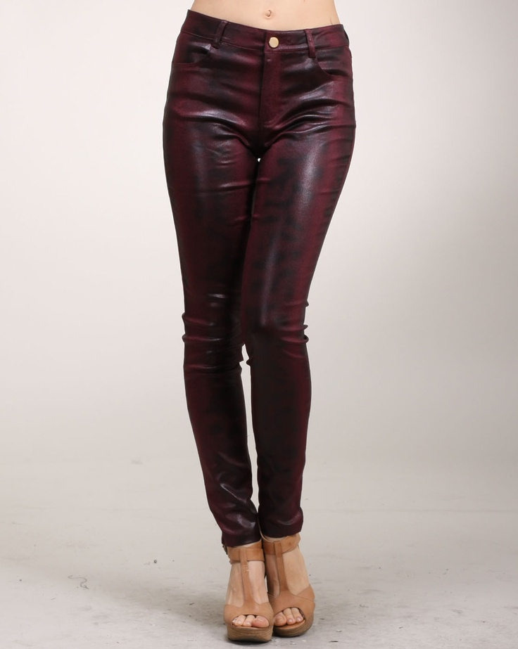 Cheryl says: If you haven't already fallen in love with the burgundy trend, then you certainly will with these wine colored pants. The pants have a skinny fit with a nice airbrush pattern with a glossy finish. The pants are made of cotton with some spandex for added stretch.