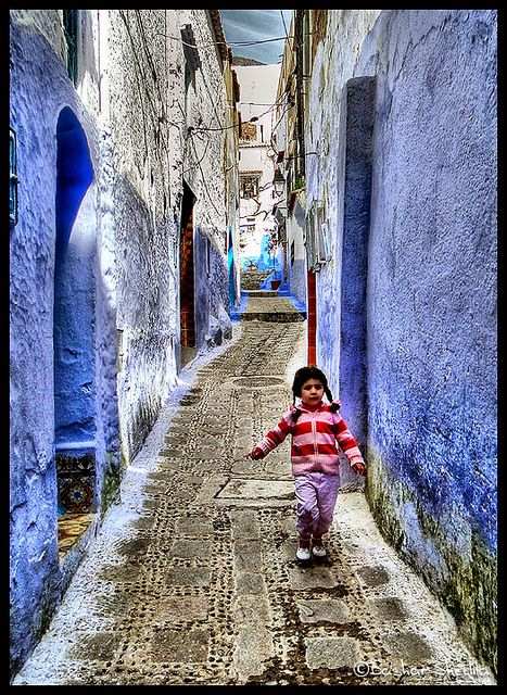 The Little Red Girl !  Chefchouen (the blue city) Morocco by Bashar Shglila, via Flickr