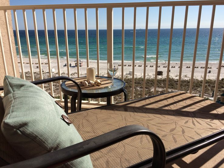 Relax on the balcony at Emerald Belle View, oceanfront vacation condo rental at Panama City Beach, FL. www.emeraldbelleview-pcb.com
