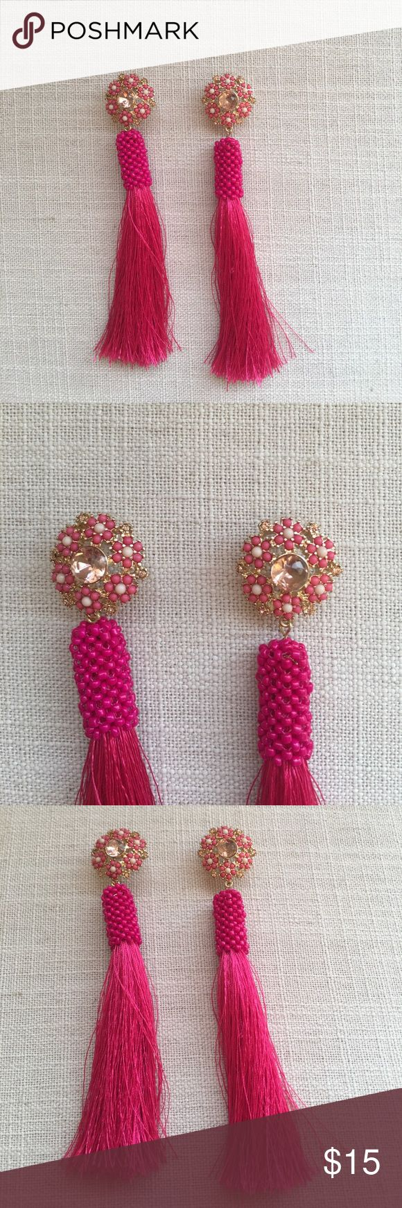 EXPRESS Pink Tassel Earrings Pink tassel earrings - new never worn - statement earrings that make a pop with a simple little black dress! Bought for vacation and never wore them. Express Jewelry Earrings