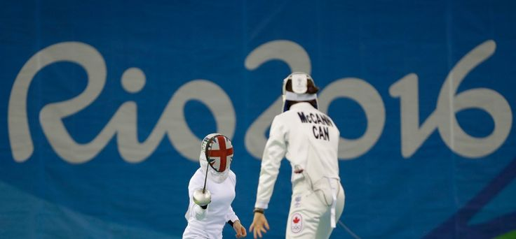 Samantha Murray of Britain, left, competes against Melanie McCann of Canada during the fencing portion of the women's modern pentathlon at the Summer Olympics in Rio de Janeiro, Brazil, Thursday, Aug. 18, 2016. (AP Photo/Kirsty Wigglesworth)