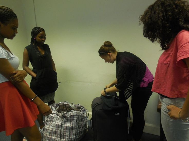 Young Producers team - the Assistants to the Costume Designer take word of advice from the Stage Manager on how to prepare the costumes for the actors right before a show.