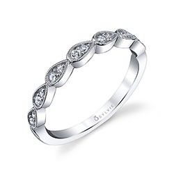 Personalize your individual style in your wedding set with this unique and vintage inspired  band in white gold featuring tear drop shaped frames with milgrain accents encircling two different sizes of shimmering round brilliant diamonds.  For fashion fun, try stacking this appealing band with other rings of different shapes, metals, and stones.  The total weight is 0.19 carats.