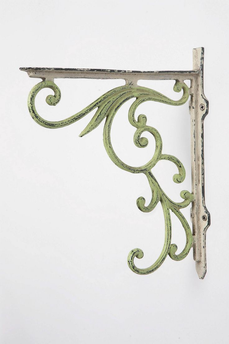 Old World Charm - Have rusted-brown brackets like this in my doorways off foyer. Don't buy the expensive ones in catalogs, buy large plant hangers from Hobby Lobby when they're half price and antique them yourself! ($30 instead of $400) :)