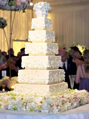 Kim Kardashian and Kanye West's wedding cake was an impressive 7- foot, 7-tier white cake with white icing and fruit layers and was served with homemade strawberry sorbet which was made by Italian caterers Galateo Ricevimenti.