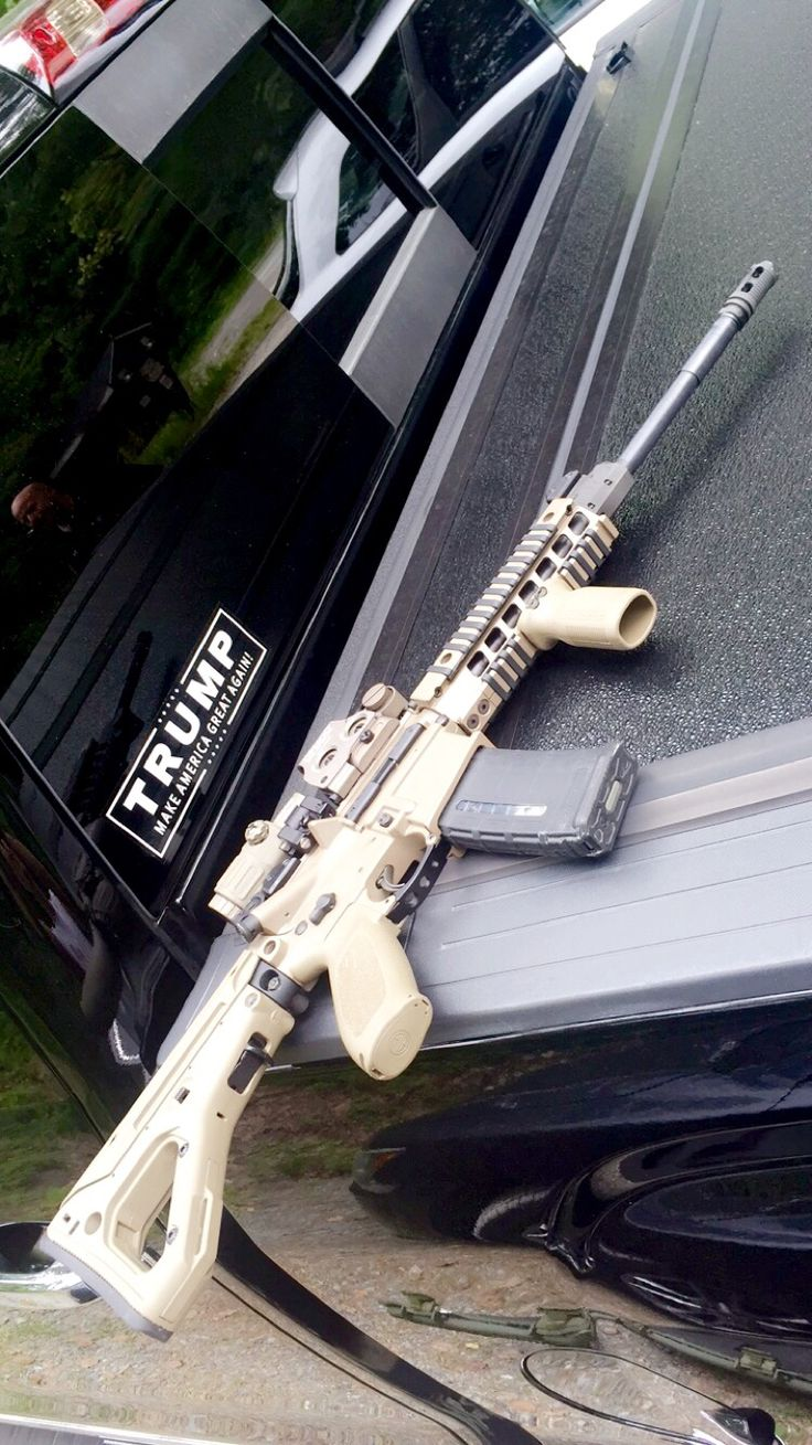 Sig 516 patrol 5.56cal FDE rifle. EOtech opmod FDE holographic/3x sight. Magpul UBR stock. Magpul foregrip. Magpul picatiny rail ladder covers.