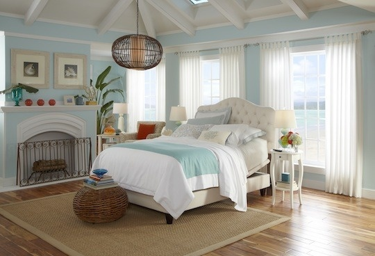 Light turquoise and white are so airy in a bedroom... also love all the sunny windows!