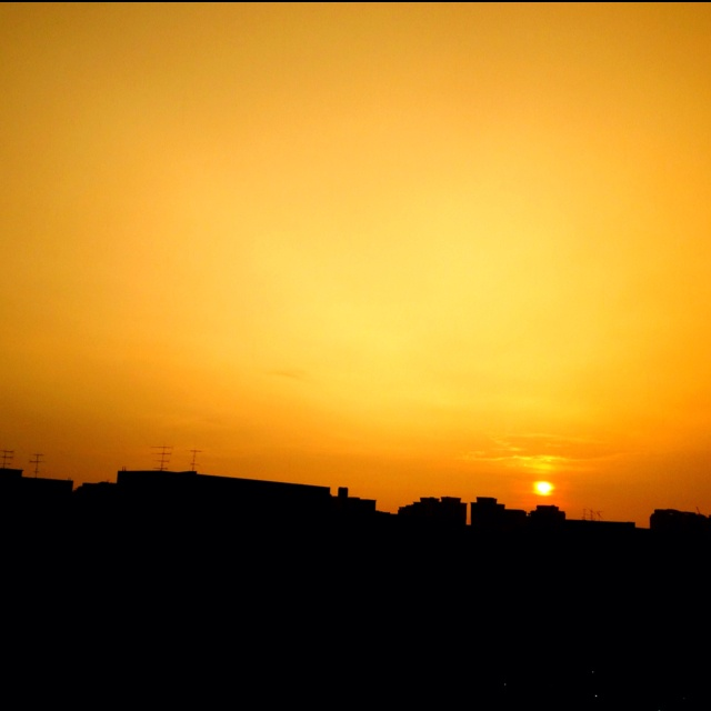 Sunset. Rain. Orange. 10 April 2012.