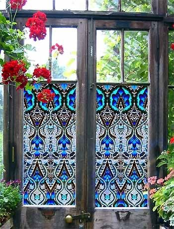 Window stickers. They have an almost stained glass Bohemian effect. And good privacy.  Gorgeous.