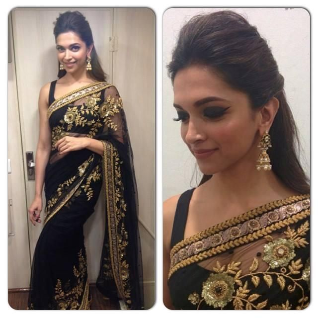 Deepika Padukone in a black and gold saree and blouse. Love the earrings and hairstyle.