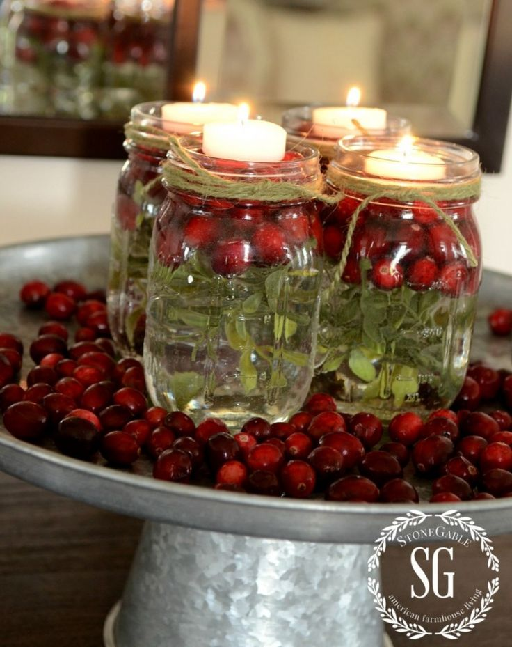 BETTER LATE THAN NEVER CHRISTMAS DECOR: A pretty sparking vignette of cranberries, and tea lights and mason jars! Put mason jars on a galvanized cake plate surrounded by cranberries for an elevated look.This Christmas decor can be created in less than 15 minutes