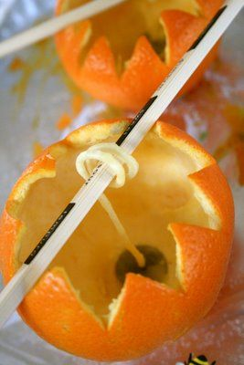 Very neat....I wonder if I could do this without mutilating the orange peel.  I might have to try with some Cuties instead.