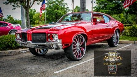 Candy Red Oldsmobile Cutlass