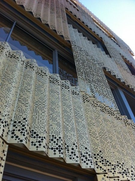 Perforated lace panels create a designer look on these apartments  #architectual #designer