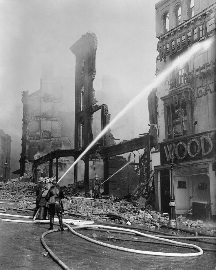 Firefighters attending the scene of destroyed buildings at the Bull Ring in the High Street, Central Birmingham, following the air raid in 1941.