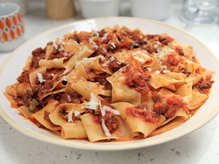 Get this all-star, easy-to-follow Spicy Sausage Bolognese with Pappardelle recipe from Rachael Ray