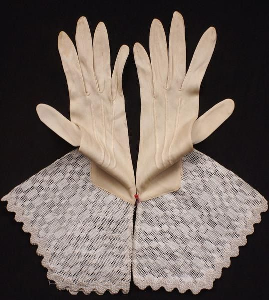 "This is a wonderful pair of vintage gloves dating to the 1930s. They are made in a ""gauntlet"" style with the bottom made of cotton ""lace"" and the hand portion made of either rayon or silk, I'm unsure"