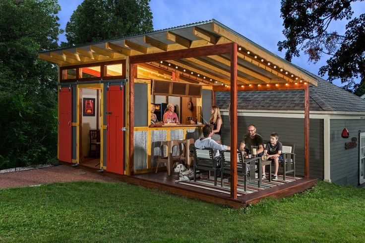 Shed bar ideas shed farmhouse with outdoor string lights outdoor string lights red barn doors