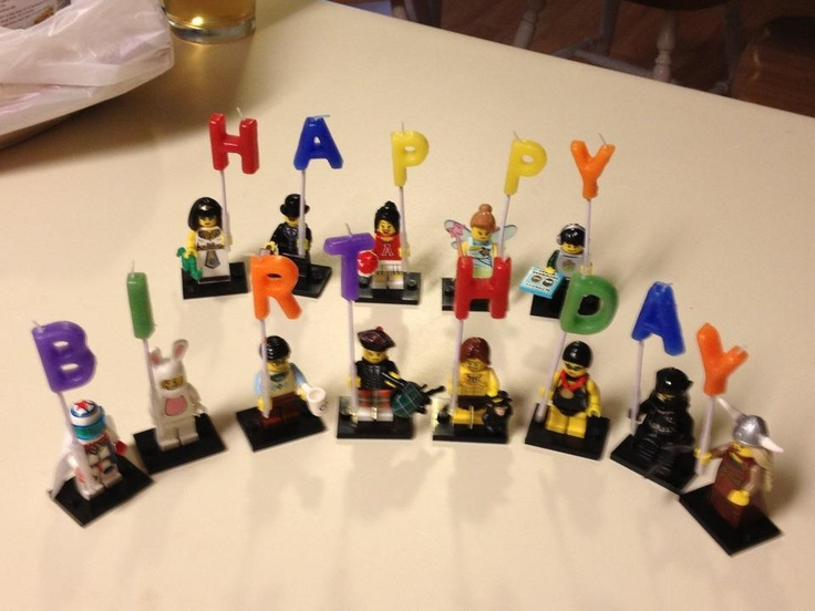 LEGO Mini figures hold birthday candles.
