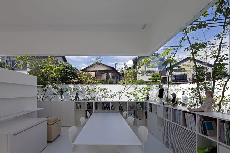 Built by UID Architects in Osaka-shi, Japan with date 2009. Images by Hiroshi Ueda. Requests and Characteristics of the Site This is an atelier for a doll artist and a residence of the couple. The requ...