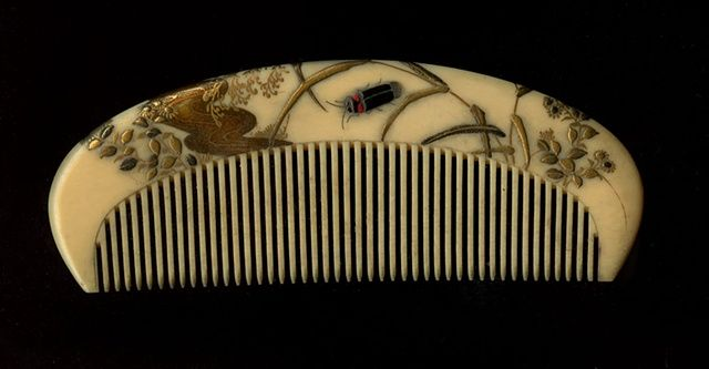 Ivory and lacquer comb from Japan with insect. (collection Miriam Slater)
