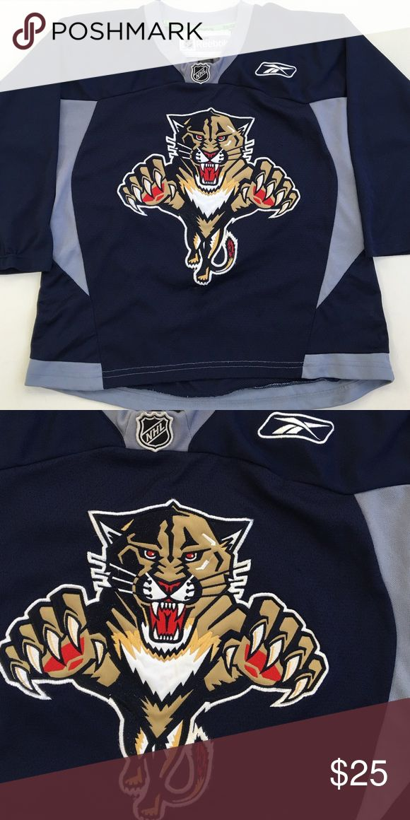 Kids NHL PANTHERS hockey jersey Size S/M Great condition NHL Panthers hockey jersey. High quality. Large embroidered center logo patch, embroidered NHL patch at neckline, embroidered Reebok symbol on chest. Reebok Shirts & Tops