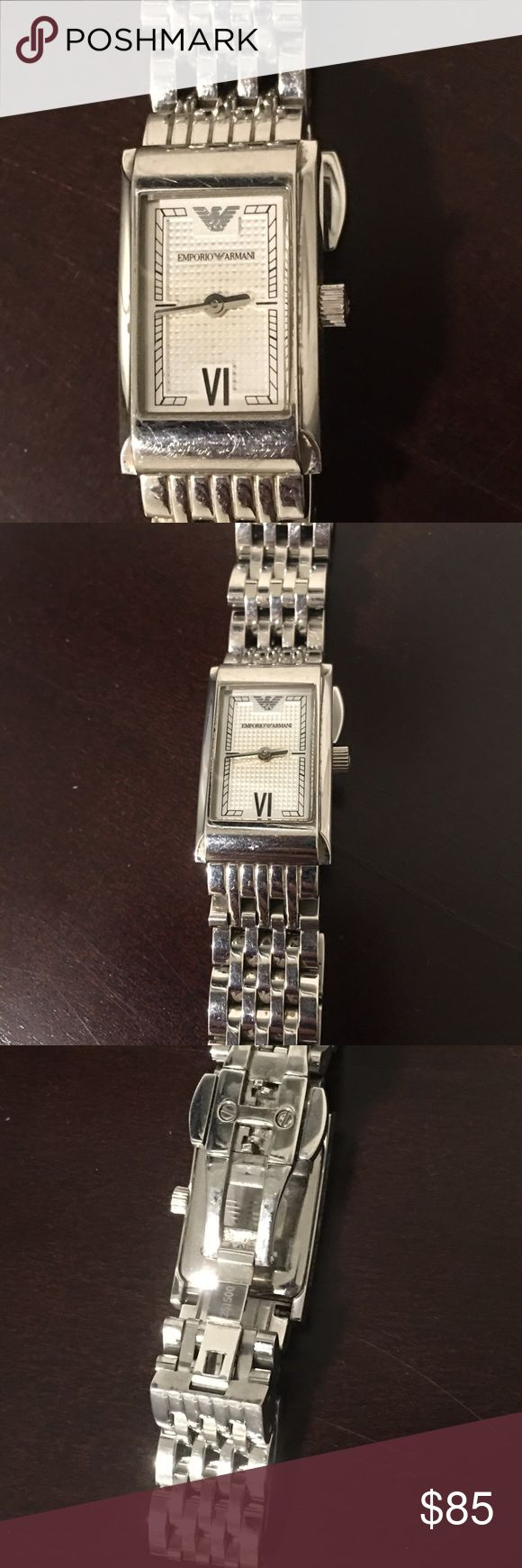 Silver Women's Emporio Armani Watch Silver Women's Emporio Armani Watch. Some wear as shown. Not all links attached but I have all links from original purchase. New battery needed. Emporio Armani Accessories Watches
