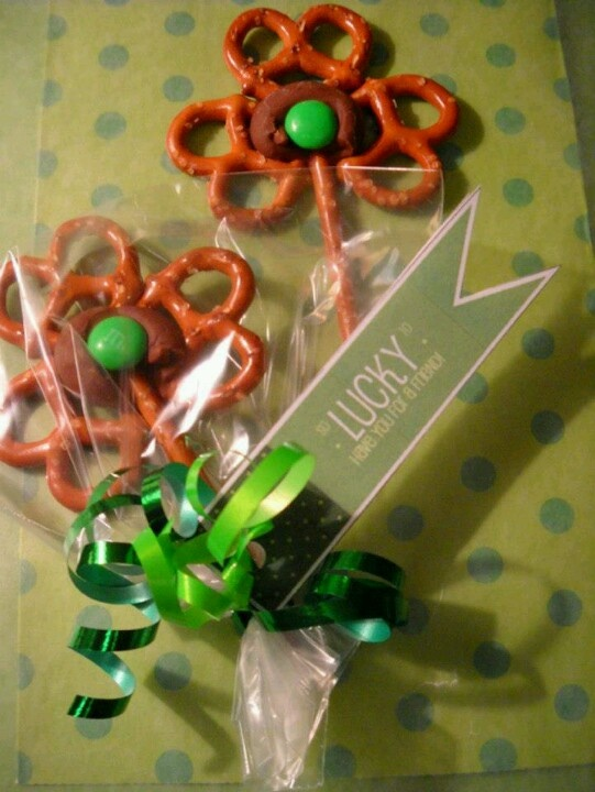 !!! Twisted shamrocks !!! A few pretzels held together with a Hershey's Kiss and an M top off this salty and sweet treat.  Baking sheet, foil or parchment paper, oven, a bag of pretzel sticks, a bag of mini pretzels, a bag (or so) of Hershey's Kisses, a large bag of M  Heat oven to 200 degrees. Line a baking sheet with foil or parchment paper. Assemble 3 pretzels like so:  place a Hershey's Kiss on top of the pretzels  Repeat until you run out of room (or Kisses). Carefully put baking sheet…