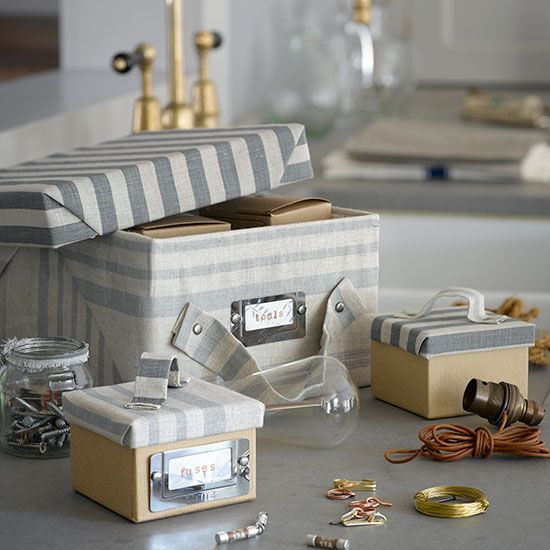 Cover damaged toy boxes and crates in wallpaper to create stylish new storage boxes