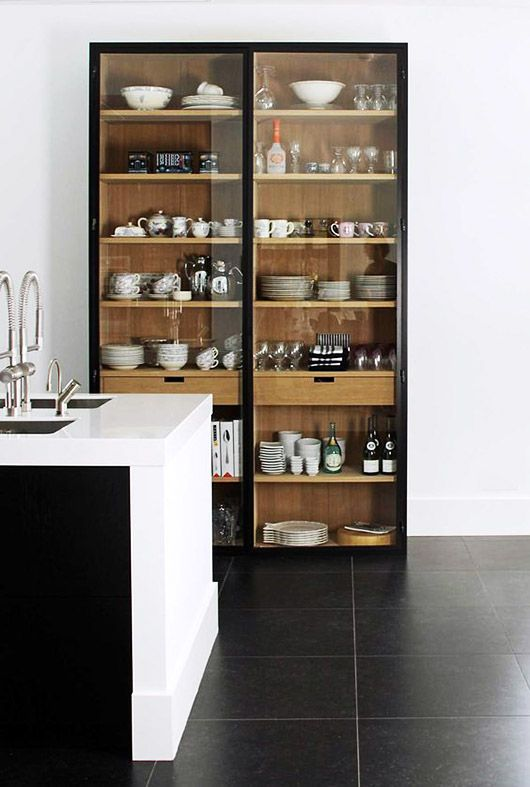 wood cabinet with dishware displayed inside with black trim / sfgirlbybay