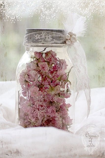 Dried flowers in clear canning jar with tulle ribbon for vintage wedding reception tabletop decor; upcycle, recycle, salvage, diy, repurpose!  For ideas and goods shop at Estate ReSale  ReDesign, Bonita Springs, FL