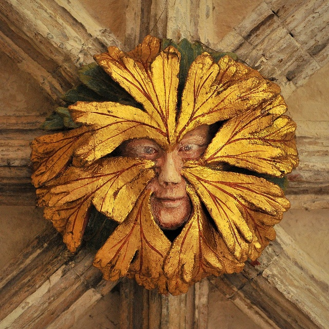 """Green Man"" a roof boss (carved ornament where beams join) at Norwich Cathedral, UK"